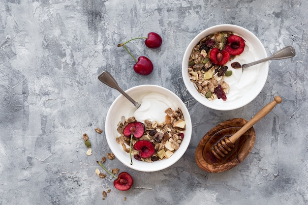 Two bowls with yogurt and fruits