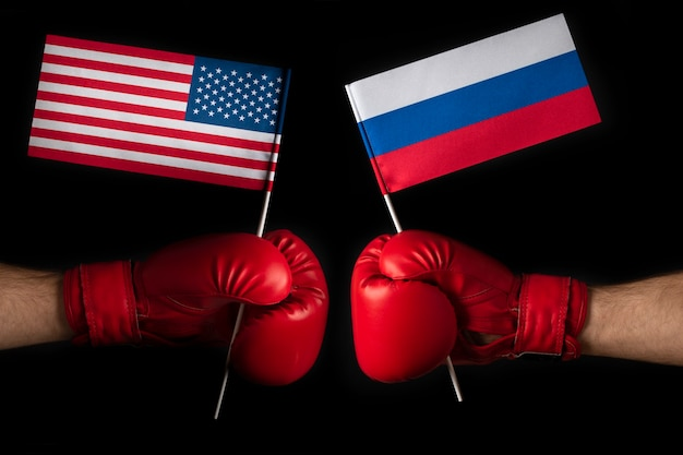 Two boxer hands with usa and russian flags. superpower confrontation concept. opposition between the united states and russia.