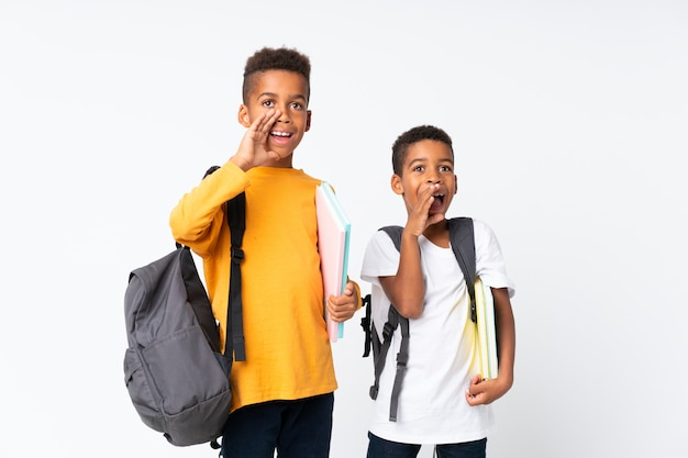 Two boys african american students over isolated white and shouting