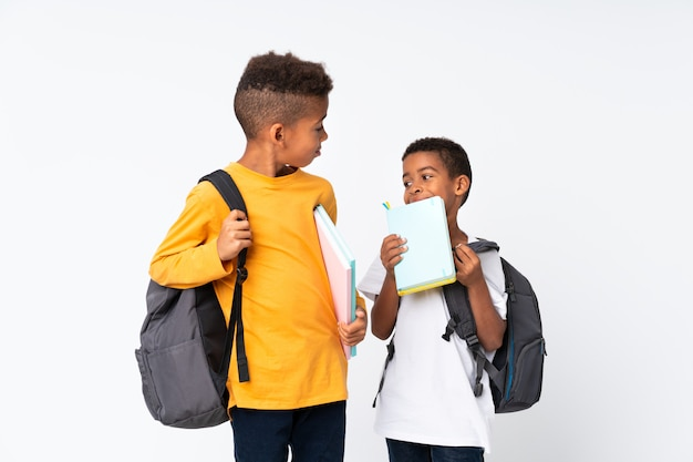 Two boys african american students over isolated white