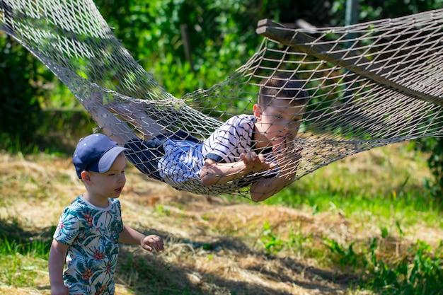 Two boys in a hammock in the garden.