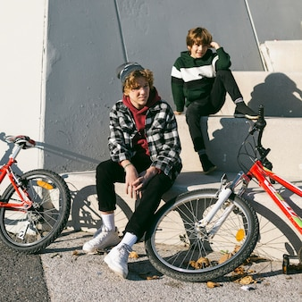 Two boys outdoors together with their bikes