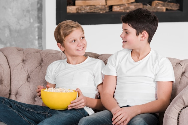 Two boys talking and sitting on couch