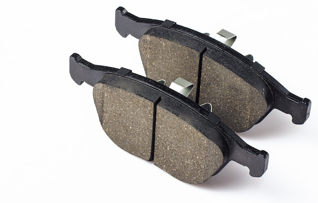 Two brake pad for disc brakes of a car. spare parts for car maintenance, brake system consumables.