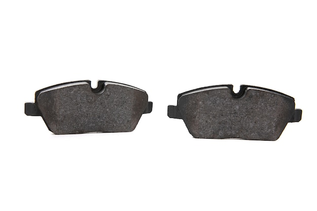 Two brake pads on an isolated white background