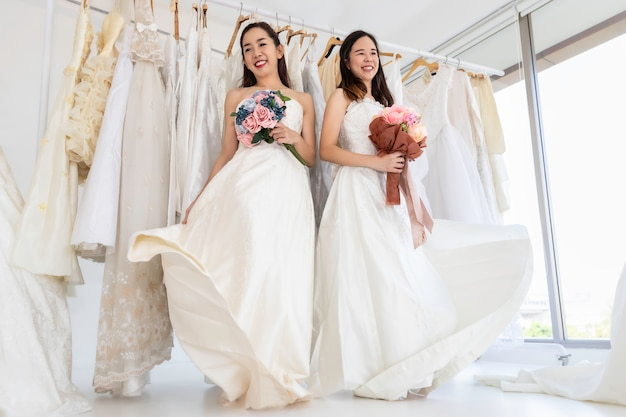 Two brides white dresses.portrait of asian homosexual couple happy in wedding moment.concept lgbt lesbian.
