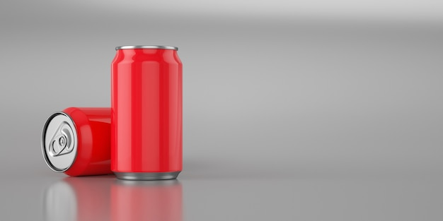 Two bright red cola cans on metal