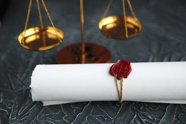 Two broken golden wedding rings divorce decree document.