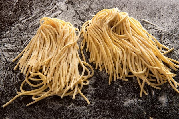 Two bundles of spaghetti