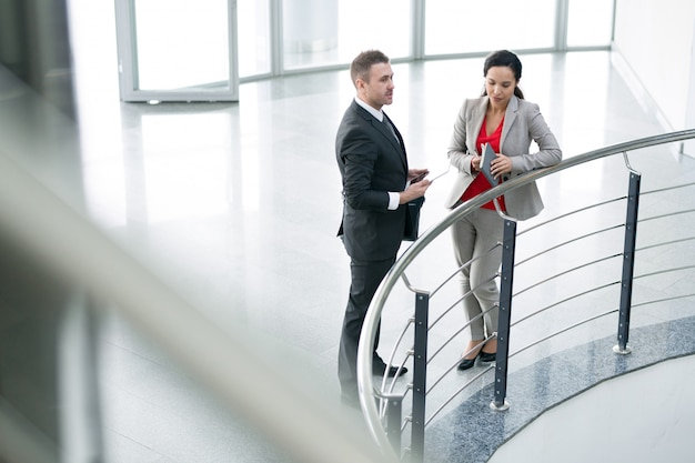 Two business colleagues talking at balcony