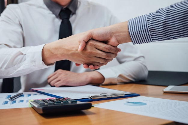 Two business handshake of collaboration after discussing good deal of trading contract