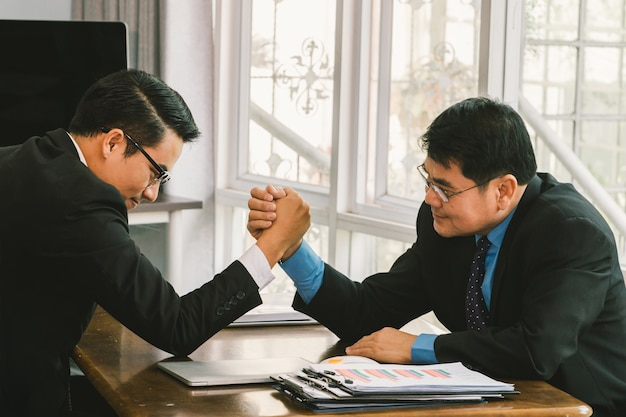 Two business men arm wrestling, business competition concept