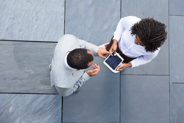 Two business partners looking at tablet