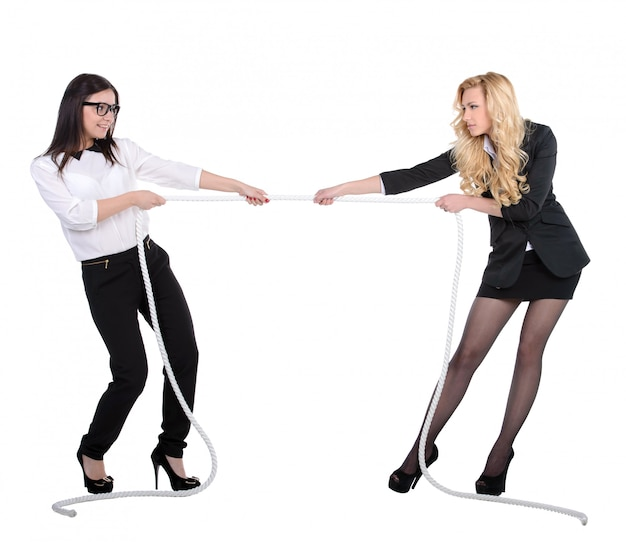 Two business women in competition pulling rope.
