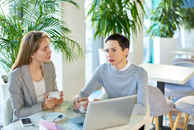 Two business women meeting in cafe