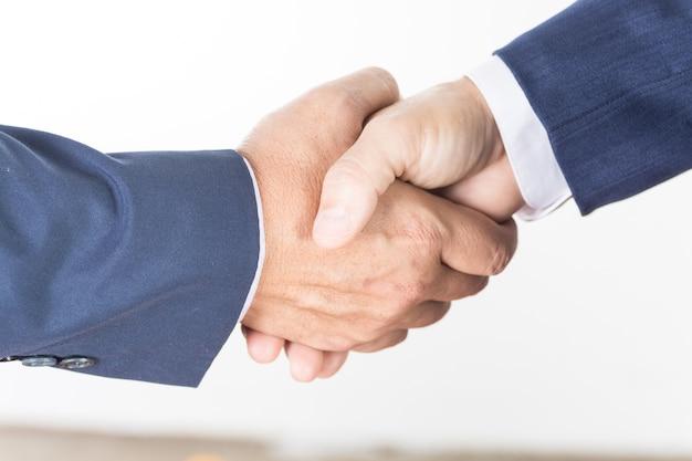 Two businessman executive hand shaking closeup