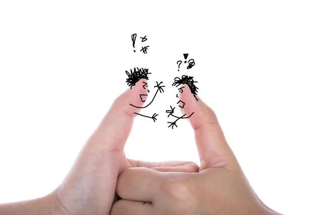 二つのビジネスマンの指は、引数を持ち、白で隔離します