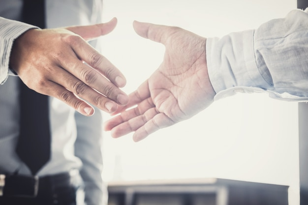 Two businessman handshake after discussing good deal of trading contract