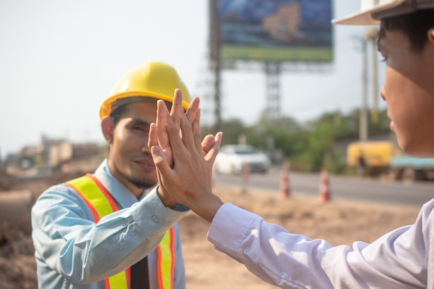Two businessman holding hand success agreement construction project