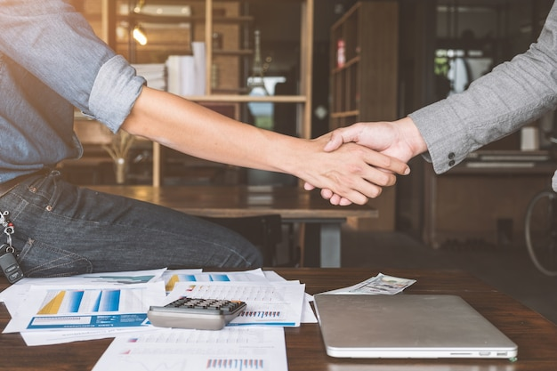 Two businessman people shaking hands with making a deal, business people shaking hands.