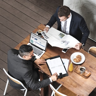Two businessmen cafe break concept