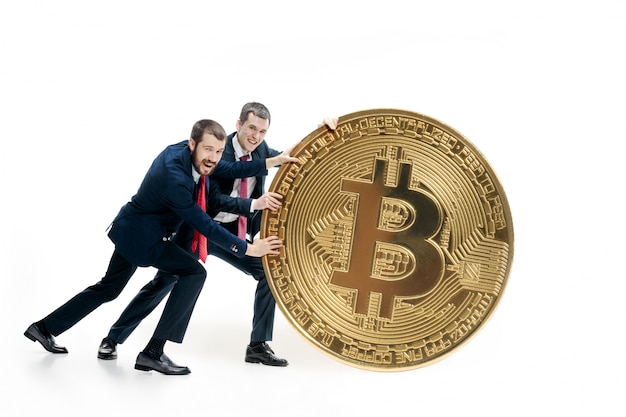 Two businessmen holding bitcoin