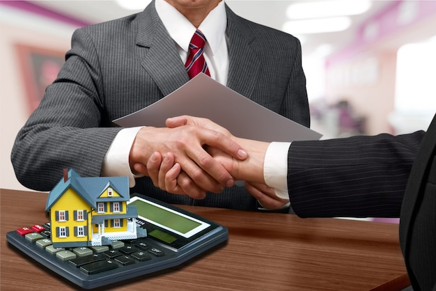 Two businessmen shaking hands - welcome to business