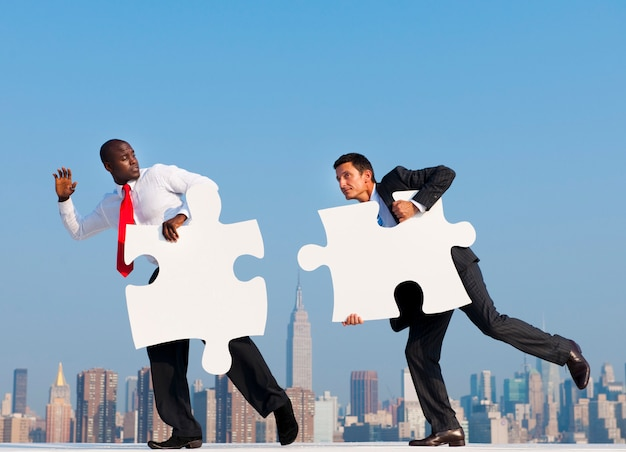 Two businessmen solving a puzzle.