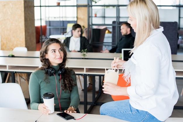 Two businesswomen on break
