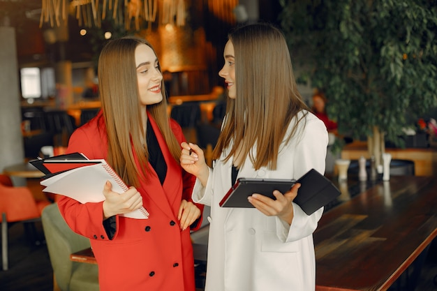 Two businesswomen working in a cafe