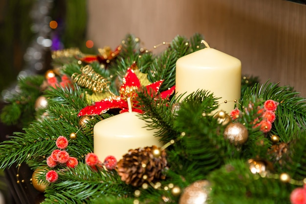 Two candles with decoration of the christmas tree