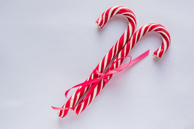 Two candy canes on white background. traditional christmas candies.