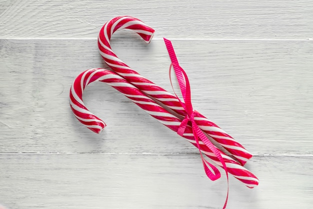 Two candy canes on wooden background. traditional christmas candies.