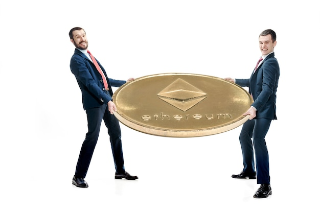 Two casual man holding business icon