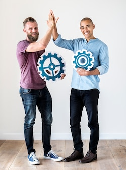 Two casual man holding cog icon