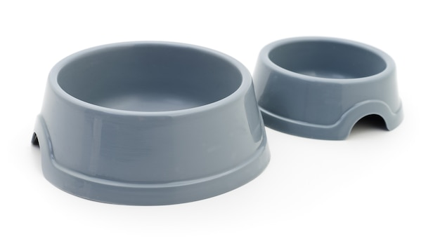 Two cat's plastic bowls on white.