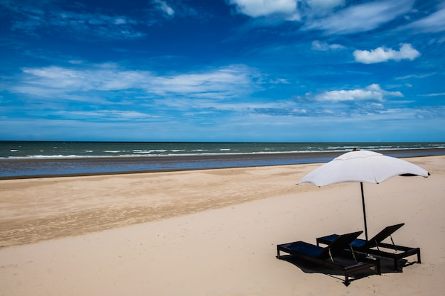 Two chair and umbrella on the beach with blue sky