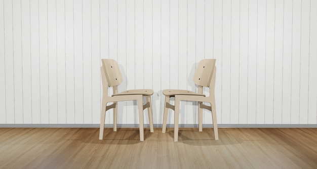 Two chairs facing each other. in the room with white wood floors