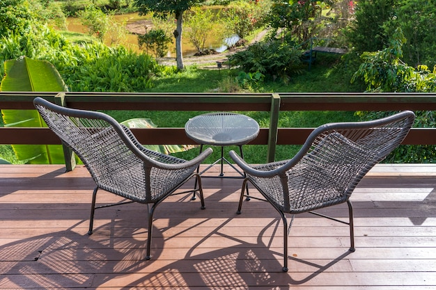 Two chairs and table on the backyard in tropical garden with beautiful view in island borneo, malaysia, close up