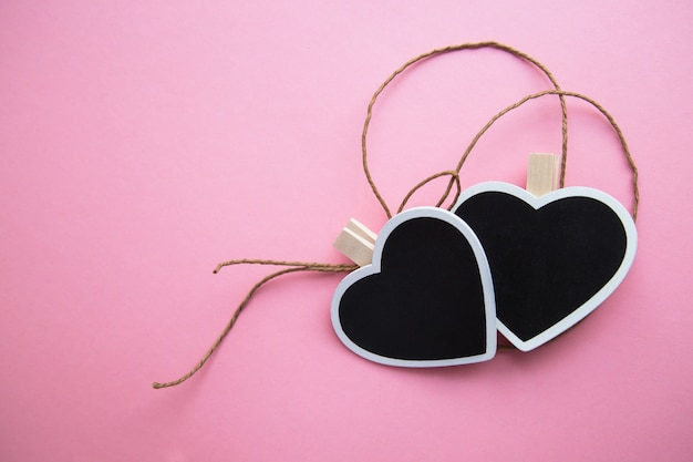 Two chalk  boards  in shape of a heart  for writing with a rope