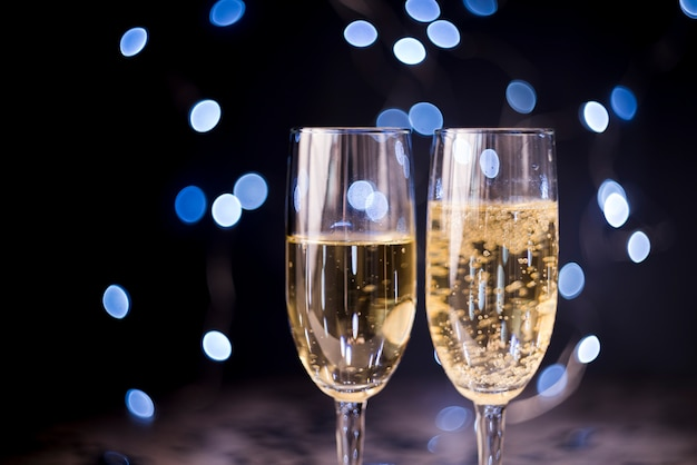 Two champagne glasses on bokeh background