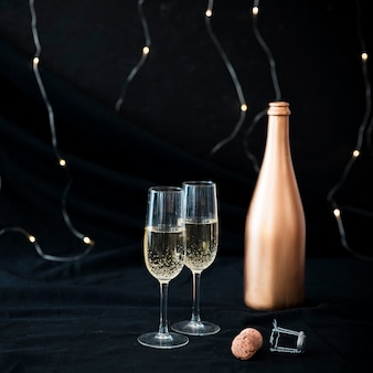 Two champagne glasses on table