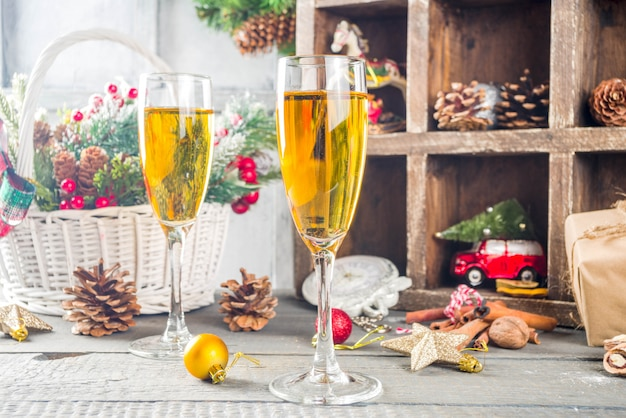 Two champagne glasses with christmas decoration