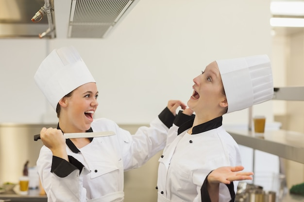 Two chef's joking in the kitchen