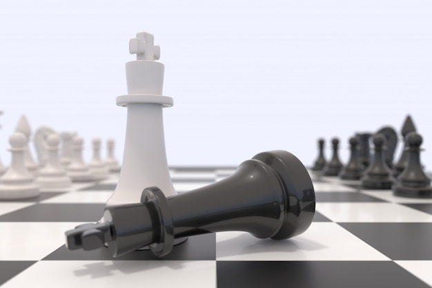 Two chess pieces on a chessboard. black king laying down and white king standing up.