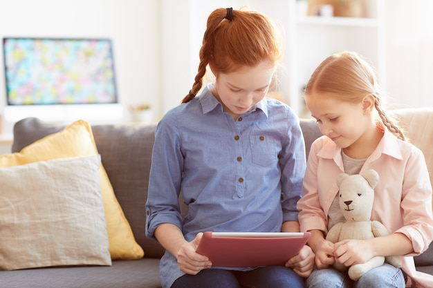 Two children using digital tablet