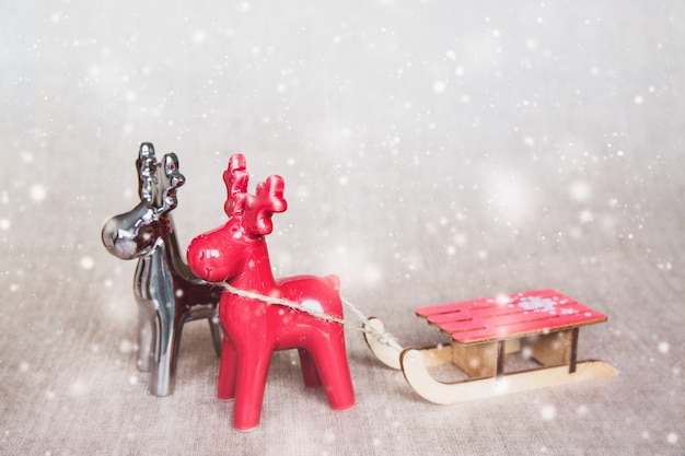 Two christmas deers with sledges.
