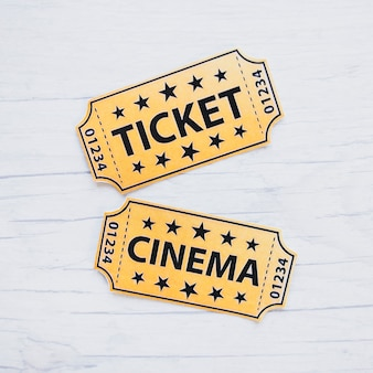 Two cinema tickets on table