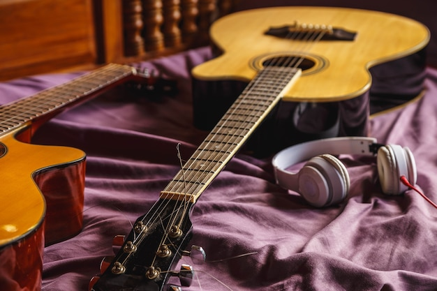 Two classic guitar in bed