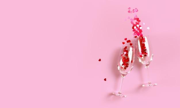 붉은 심장의 스플래시와 두 부딪 치는 샴페인 잔은 분홍색 배경 위에 색종이 모양. 상위 뷰, 복사 공간. 3d 렌더링.